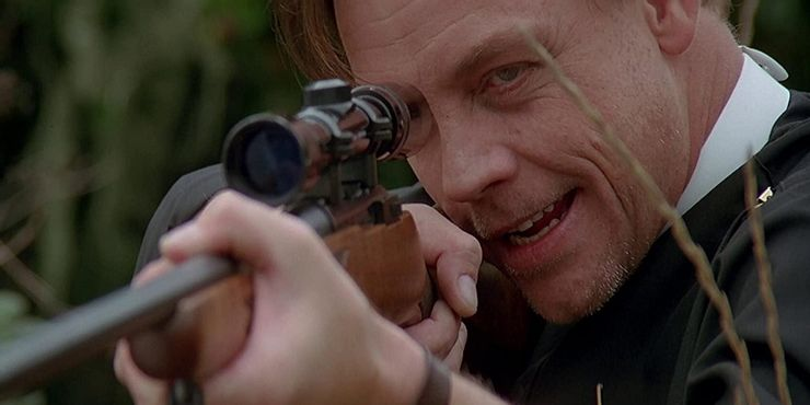Hamill with rifle
